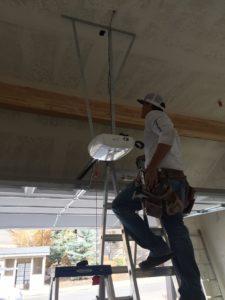 One of our workers doing a garage door repair in Provo, Utah.